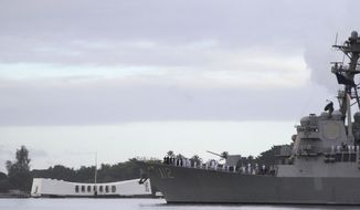The USS Michael Murphy passes by the USS Arizona Memorial in Pearl Harbor, Hawaii on Friday, Dec. 7, 2018 during a ceremony marking the 77th anniversary of the Japanese attack. The Navy and National Park Service jointly hosted the remembrance ceremony at a grassy site overlooking the water and the USS Arizona Memorial. (AP Photo/Audrey McAvoy) **FILE**