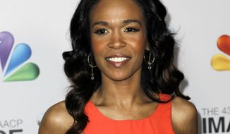 """FILE - This Feb. 17, 2012 file photo shows singer-actress Michelle Williams at the 43rd NAACP Image Awards in Los Angeles.  The Destiny's Child singer announced on Friday, Dec. 7, 2018,  that her engagement to 40-year-old pastor Chad Johnson is over. The 38-year-old wrote on Instagram that """"things didn't work out."""" Williams says she doesn't want to """"destroy another relationship."""" The announcement came the same day that Williams released her new single, """"Fearless.""""  (AP Photo/Matt Sayles, File)"""