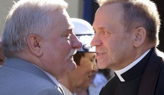 FILE - In this June 18, 2005 file photo former President Lech Walesa, left, welcomes father Henryk Jankowski at a party in Walesa's honor in Gdansk, Poland. Allegations against the late Mgr. Jankowski, one of the key figures in the Solidarity 1980 strikes, surfaced this week that he sexually abused minors. ( AP Photo/Czarek Sokolowski)