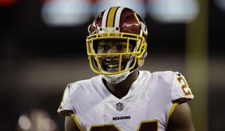 FILE - In this Dec. 3, 2018, file photo, Washington Redskins' Josh Norman reacts during the second half of an NFL football game against the Philadelphia Eagles in Philadelphia. Norman says the Redskins' defense needs to figure out a way to stop opponents on third down if Washington is going to get back to its winning ways. The defense's solid play was a big part of why the Redskins started the season 5-2 and the unit's struggles are a big part of why the club is on a three-game losing streak. (AP Photo/Matt Rourke) **FILE**