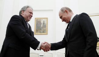 Greek acting Foreign Minister Georgios Katrougalos (left) met earlier this month in Moscow with Russian President Vladimir Putin. Mr. Katrougalos said Greece considers Russia to be one of the most important challenges of our time and hopes to reintegrate it in the European regional system of security. (Associated Press/File)