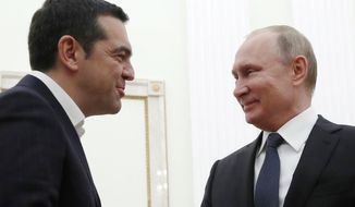 Greek Prime Minister Alexis Tsipras, left, and Russian President Vladimir Putin talk to each other during their meeting in the Kremlin in Moscow, Russia, Friday, Dec. 7, 2018. (Maxim Shemetov, Pool Photo via AP)