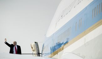 President Donald Trump boards Air Force One at Kansas City International Airport in Kansas City, Mo., Friday, Dec. 7, 2018, to travel to Andrews Air Force Base, Md., after speaking at the 2018 Project Safe Neighborhoods National Conference. (AP Photo/Andrew Harnik)