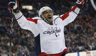 Washington Capitals' Alex Ovechkin, of Russia, celebrates their goal against the Columbus Blue Jackets during the third period of an NHL hockey game, Saturday, Dec. 8, 2018, in Columbus, Ohio. The Capitals beat the Blue Jackets 4-0. (AP Photo/Jay LaPrete)