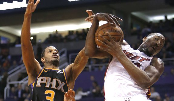 Phoenix Suns forward Trevor Ariza (3) in the first half during an NBA basketball game against the Miami Heat, Friday, Dec. 7, 2018, in Phoenix. (AP Photo/Rick Scuteri) **FILE**