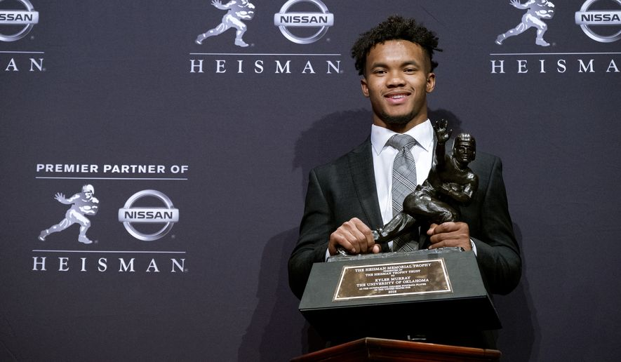 Oklahoma quarterback Kyler Murray holds the Heisman Trophy after winning the award Saturday, Dec. 8, 2018, in New York. (AP Photo/Craig Ruttle) ** FILE **