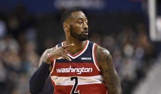 Washington Wizards guard John Wall (2) gestures during the second half of an NBA basketball game against the Brooklyn Nets, Saturday, Dec. 1, 2018, in Washington. The Wizards won 102-88. (AP Photo/Nick Wass) ** FILE **