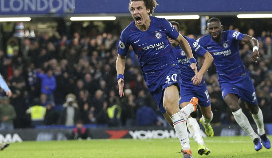 Chelsea's David Luiz, left, celebrates after scoring his side's opening goal during the English Premier League soccer match between Chelsea and Manchester City at Stamford Bridge in London, Saturday Dec. 8, 2018. (AP Photo/Tim Ireland)