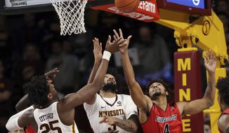 Arkansas State's Tristin Walley (4) reaches for a loose ball against Minnesota's Jordan Murphy and Daniel Oturu during  the first half of an NCAA college basketball game Saturday, Dec. 8, 2018, in Minneapolis. (AP Photo/Stacy Bengs)