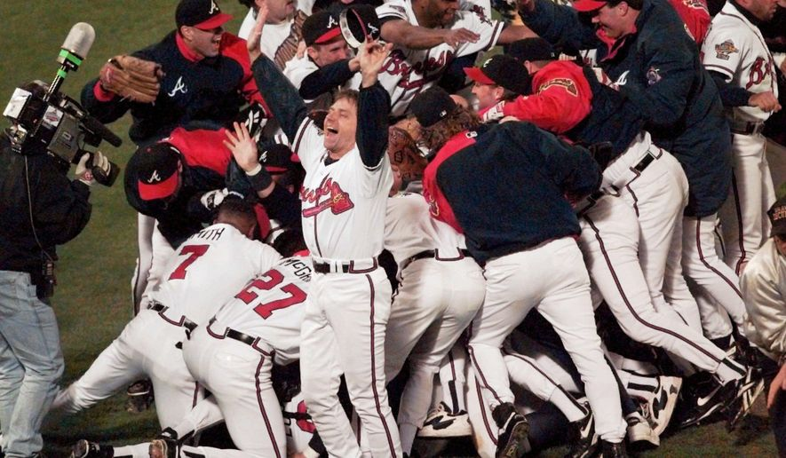 FILE - In this Oct. 28, 1995, file photo, the Atlanta Braves celebrate after Game 6 of the baseball World Series in Atlanta. The Braves defeated the Cleveland Indians 1-0 to win the series. When Atlanta United reached Saturday's MLS Cup final, the soccer team moved to the cusp of a truly rare accomplishment. There hasn't been a big league champion in this city since the Braves' title. (AP Photo/Ed Reinke, File)