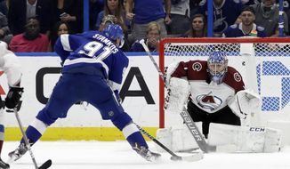 Tampa Bay Lightning center Steven Stamkos (91) prepares to score on Colorado Avalanche goaltender Semyon Varlamov (1) during the first period of an NHL hockey game Saturday, Dec. 8, 2018, in Tampa, Fla. (AP Photo/Chris O'Meara)