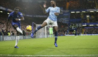 Chelsea's Antonio Rudiger, left, and Manchester City's Raheem Sterling compete for the ball during the English Premier League soccer match between Chelsea and Manchester City at Stamford Bridge in London, Saturday Dec. 8, 2018. (AP Photo/Tim Ireland)