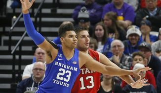 Utah forward Novak Topalovic (13) guards BYU forward Yoeli Childs (23) in the second half during an NCAA college basketball game, Saturday Dec. 8, 2018, in Salt Lake City. (AP Photo/Rick Bowmer)