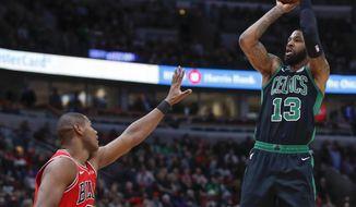 Boston Celtics forward Marcus Morris, right, shoots over Chicago Bulls forward Cristiano Felicio during the second half of an NBA basketball game Saturday, Dec. 8, 2018, in Chicago. (AP Photo/Kamil Krzaczynski
