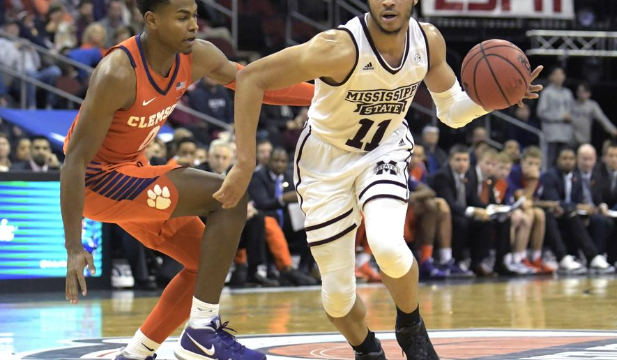 Mississippi State guard Quinndary Weatherspoon (11) drives to the basket as he is guarded by Clemson guard Clyde Trapp (0) during the second half of an NCAA college basketball game in the Never Forget Tribute Classic Saturday, Dec. 8, 2018, in Newark, N.J. Mississippi State won 82-71. (AP Photo/Bill Kostroun)