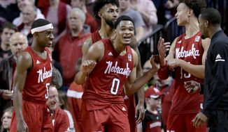 Nebraska starters Glynn Watson Jr. (5), James Palmer Jr. (0), Isaiah Roby (15) and Isaac Copeland Jr., rear, celebrate in the closing seconds of the team's NCAA college basketball game against Creighton in Lincoln, Neb., Saturday, Dec. 8, 2018. Nebraska won 94-75. (AP Photo/Nati Harnik)