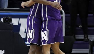 Northwestern forward Vic Law, left, forward A.J. Turner celebrate after Northwestern defeated DePaul 75-68 in an NCAA college basketball game Saturday, Dec. 8, 2018, in Evanston, Ill. (AP Photo/Nam Y. Huh)