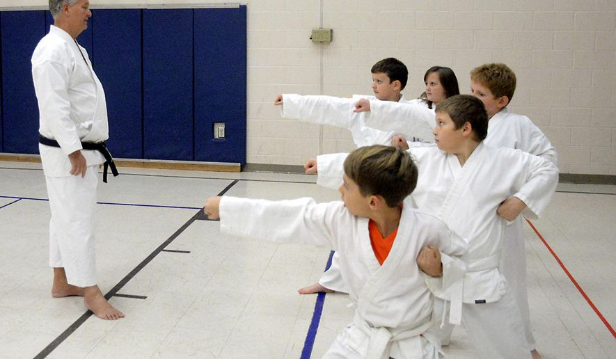 In this Oct. 29, 2018 photo at Central Christian Church in Fairmont, West Virginia, Sensei Jerry Eagle instructs the students in his karate class in performing a striking move in the name of self-defense. (Eddie Trizzino/Times West Virginian, via AP)