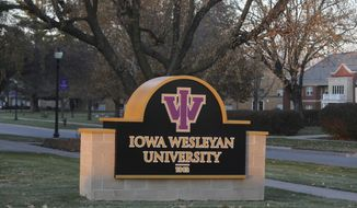 In this Thursday, Nov. 15, 2018 photo, Iowa Wesleyan University will continue as southeast Iowa's only four-year degree-granting university, officials at the 176-year-old college announced on the Mount Pleasant, Iowa, campus. Iowa Wesleyan adopted its service learning approach in 1967, and it now provides Old Threshers, a major economic and tourism draw for the community, with numerous student volunteers. (John Gaines/The Hawk Eye via AP)