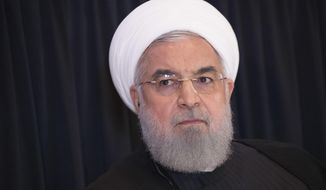 FILE - In this Sept. 26, 2018, file photo, Iranian President Hassan Rouhani speaks during a news conference in New York. President Rouhani is warning Western countries that they will face a massive influx of drugs if Iran becomes weakened by U.S. sanctions. Rouhani spoke in Tehran on Saturday, Dec. 8, 2018, at a six-nation conference on fighting terrorism attended by parliament speakers of Afghanistan, Iran, Pakistan, Turkey, China and Russia. (AP Photo/Mary Altaffer, File)
