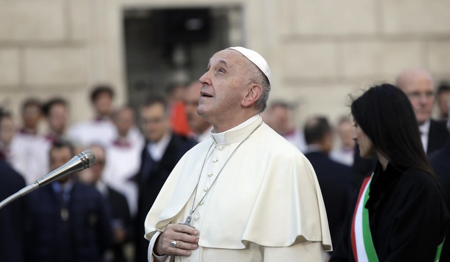 Pope Francis looks at the statue of the Virgin Mary, near Rome's Spanish Steps, Saturday, Dec. 8, 2018, an annual tradition marking the start of the city's holiday season. (AP Photo/Alessandra Tarantino)