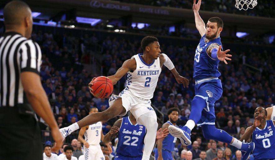 Seton Hall forward Sandro Mamukelashvili (23) defends against Kentucky guard Ashton Hagans (2) during the first half of an NCAA basketball game, Saturday, Dec. 8, 2018, in New York. (AP Photo/Noah K. Murray)