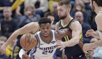 Indiana Pacers forward Domantas Sabonis (11) defends Sacramento Kings guard Buddy Hield (24) during the second half of an NBA basketball game in Indianapolis, Saturday, Dec. 8, 2018. The Pacers defeated the Kings 107-97. (AP Photo/Michael Conroy)