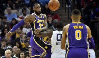 Los Angeles Lakers forward LeBron James (23) passes the ball against Memphis Grizzlies forward JaMychal Green (0) in the first half of an NBA basketball game on Saturday, Dec. 8, 2018, in Memphis, Tenn. (AP Photo/Brandon Dill)