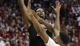 Louisville's Steven Enoch (23) shoots over Indiana's Juwan Morgan (13) during the first half of an NCAA college basketball game, Saturday, Dec. 8, 2018, in Bloomington, Ind. (AP Photo/Darron Cummings)