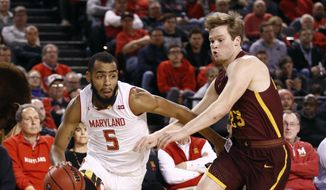 Maryland guard Eric Ayala, left, drives past Loyola-Chicago guard Cooper Kaifes in the first half of an NCAA college basketball game, Saturday, Dec. 8, 2018, in Baltimore. (AP Photo/Patrick Semansky)