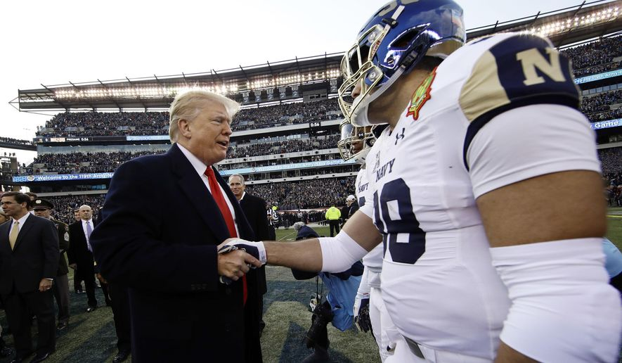President Donald Trump meets with Navy player Anthony Gargiulo ahead of an NCAA college football game between Army and Navy, Saturday, Dec. 8, 2018, in Philadelphia. (AP Photo/Matt Rourke)