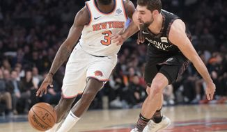 New York Knicks guard Tim Hardaway Jr. (3) drives to the basket against Brooklyn Nets forward Joe Harris during the first half of an NBA basketball game, Saturday, Dec. 8, 2018, at Madison Square Garden in New York. (AP Photo/Mary Altaffer)