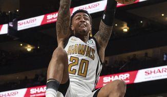Atlanta Hawks forward John Collins (20) dunks against the Denver Nuggets during the first half of an NBA basketball game Saturday, Dec. 8, 2018, in Atlanta. (AP Photo/Danny Karnik)