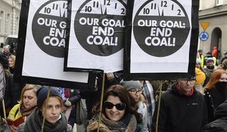 Climate activists attend the March for Climate in a protest against global warming in Katowice, Poland, Saturday, Dec. 8, 2018, as the COP24 U.N. Climate Change Conference takes place in the city. (AP Photo/Alik Keplicz)