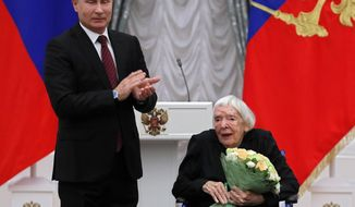 FILE In this file photo taken on Monday, Dec. 18, 2017, Russian President Vladimir Putin, left, congratulates the Moscow Helsinki Group Chair and human rights activist Lyudmila Alexeyeva, during a ceremony to present the 2017 State Awards for Outstanding Achievements in Human Rights and and Charity Work in the Kremlin in Moscow, Russia . Alexeyeva, who was forced into exile by Soviet authorities after founding Russia's oldest human rights organization in 1976, passed away in a Moscow hospital Friday, Dec. 7, 2018 at age 91. (Yuri Kochetkov/Pool Photo via AP, File)