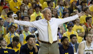 Michigan head coach John Beilein argues a call in the first half of an NCAA college basketball game against South Carolina in Ann Arbor, Mich., Saturday, Dec. 8, 2018. (AP Photo/Paul Sancya)