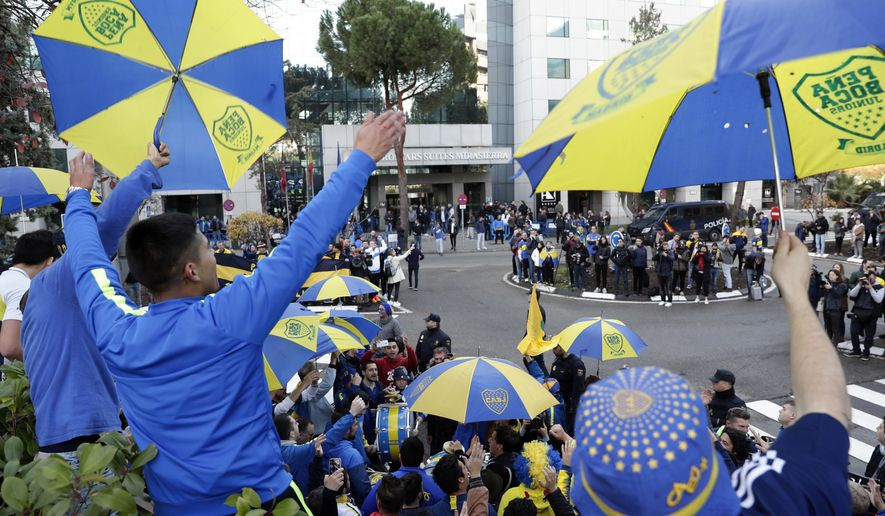Boca Juniors supporters gather outside the team hotel in Madrid Saturday, Dec. 8, 2018. The Copa Libertadores Final between River Plate and Boca Juniors will be played on Dec. 9 in Madrid, Spain, at Real Madrid's stadium. (AP Photo/Manu Fernandez)