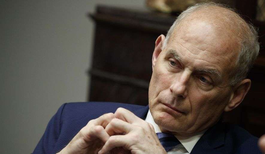 In this June 21, 2018 photo, then-White House chief of staff John Kelly listens as President Donald Trump speaks during a lunch with governors in the Roosevelt Room of the White House in Washington. (AP Photo/Evan Vucci) **FILE**