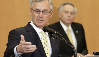 """FILE - In this Feb. 2, 2012 file photo, Former Ohio State football coach Jim Tressel speaks after being introduced as the new vice president for strategic engagement at the University of Akron in Akron, Ohio.  Youngstown State University's trustees and its president have agreed to extend Tressel contract through June 2020. The university's Board of Trustees and  Tressel recently agreed to the one-year extension. Board Chair Dee Crawford said in a statement that the former Ohio State University football coach has """"excelled"""" in leading the university the past four years.(AP Photo/Mark Duncan)"""