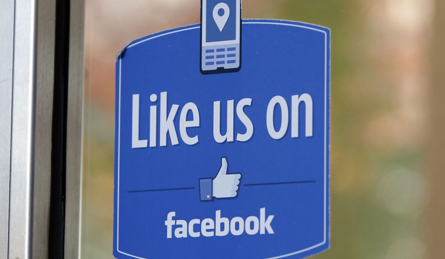 "FILE - In this Dec. 13, 2011 file photo, a sign with Facebook's ""Like"" logo is posted at Facebook headquarters near the office for the company's User Operations Safety Team in Menlo Park, Calif.  Celebrities, businesses and even the U.S. State Department have bought bogus Facebook likes, Twitter followers or YouTube viewers from offshore ""click farms,"" where workers tap, tap, tap the thumbs up button, view videos or retweet comments to inflate social media numbers. (AP Photo/Paul Sakuma, File)"
