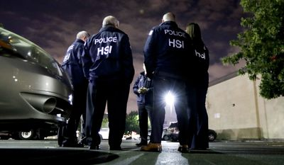 U.S. Immigration and Customs Enforcement agents gather before serving a employment audit notice at a 7-Eleven convenience store Wednesday, Jan. 10, 2018, in Los Angeles. Agents said they targeted about 100 7-Eleven stores nationwide Wednesday to open employment audits and interview workers. (AP Photo/Chris Carlson)