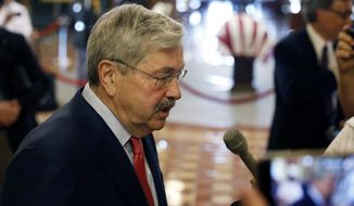U.S. Ambassador to China and former Iowa Gov. Terry Branstad speaks to reporters following a memorial service for former Iowa Gov. Robert Ray, Thursday, July 12, 2018, at the Statehouse in Des Moines, Iowa. (AP Photo/Charlie Neibergall)