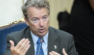 Sen. Rand Paul speaks during his meeting with Russian lawmakers in Moscow, Russia, Monday, Aug. 6, 2018. Paul said he invited Russian lawmakers to visit the United States to help foster inter-parliamentary contacts. (AP Photo/Pavel Golovkin)  ** FILE **