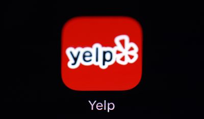 "This March 19, 2018, file photo shows the Yelp app on an iPad in Baltimore. Yelp is adding a new ""Business Accused of Racist Behavior Alert"" to its app which will inform users of news articles about businesses which have been accused of racist behavior towards employees or patrons.  (AP Photo/Patrick Semansky, File)"
