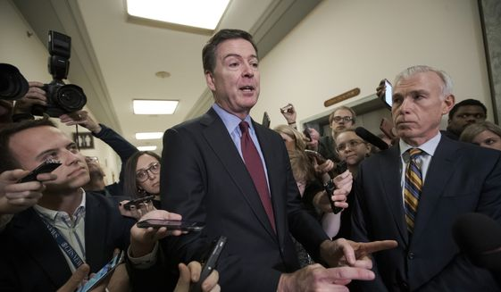 Former FBI Director James Comey, with his attorney, David Kelley, right, speaks to reporters after a day of testimony compelled by the GOP-led House Judiciary and Oversight committees, on Capitol Hill in Washington, Friday, Dec. 7, 2018. (AP Photo/J. Scott Applewhite)