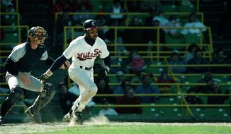 Harold Baines of the Chicago White Sox hits his 155th career home run during the third inning against the Baltimore Orioles in Chicago, Ill., Wednesday night, July 22, 1987. The home run set a club record. The White Sox lost the game 10-5. (AP Photo/Fred Jewell) **FILE**