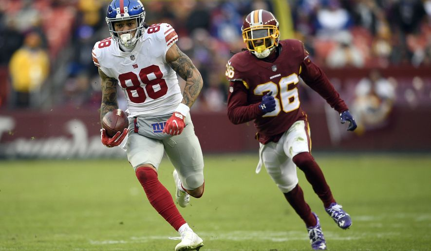 New York Giants tight end Evan Engram (88) runs from Washington Redskins free safety D.J. Swearinger (36) during the second half of an NFL football game Sunday, Dec. 9, 2018, in Landover, Md. (AP Photo/Nick Wass)