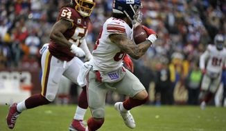 New York Giants tight end Evan Engram (88) runs the ball against Washington Redskins inside linebacker Mason Foster (54) during an NFL football game, Sunday, Dec. 9, 2018, in Landover, Md. (AP Photo/Mark Tenally)