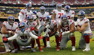 New York Giants wide receiver Bennie Fowler (18) and others celebrate his touchdown during the first half of an NFL football game against the Washington Redskins, Sunday, Dec. 9, 2018, in Landover, Md. (AP Photo/Patrick Semansky)