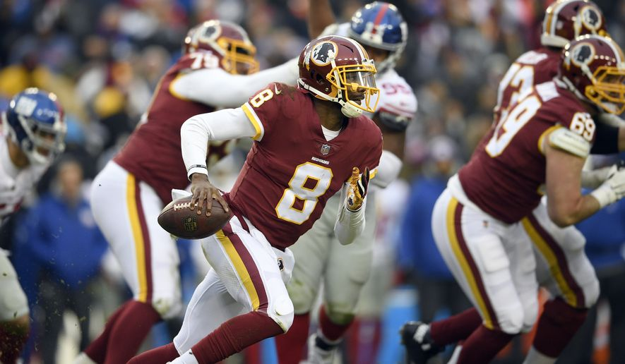Washington Redskins quarterback Josh Johnson runs with the ball during the second half of an NFL football game against the New York Giants, Sunday, Dec. 9, 2018, in Landover, Md. (AP Photo/Nick Wass)